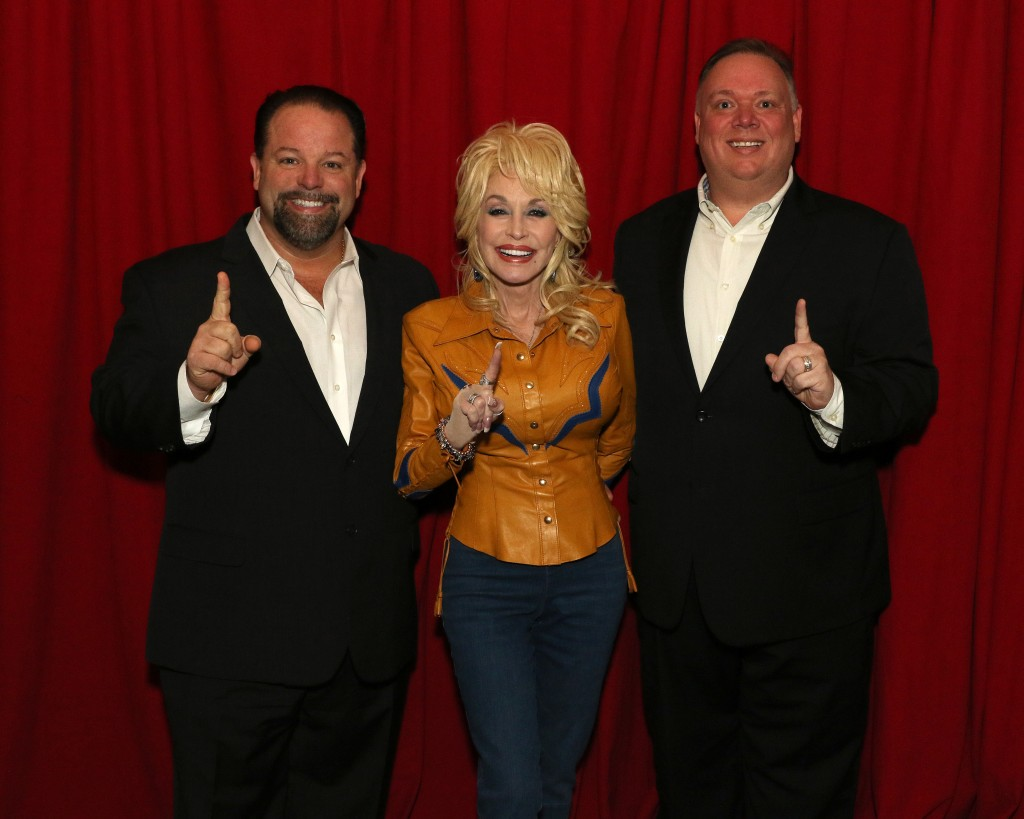 Left to right: Danny Nozell, CEO, CTK Management; Dolly Parton; and, Kirt Webster, President/CEO, Webster Public Relations